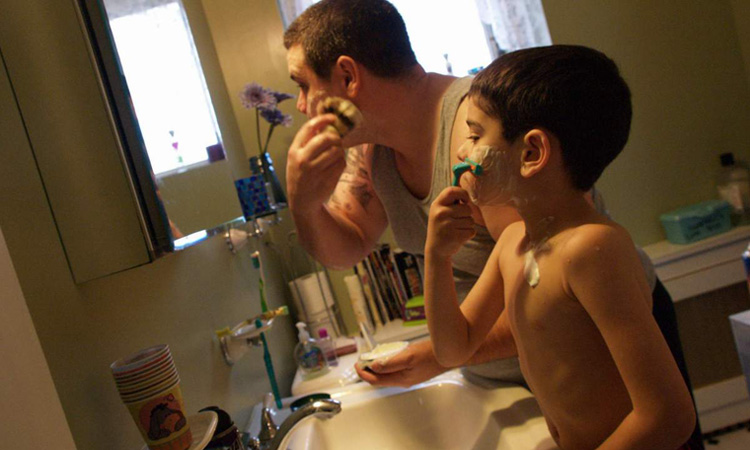Father and son shaving beards