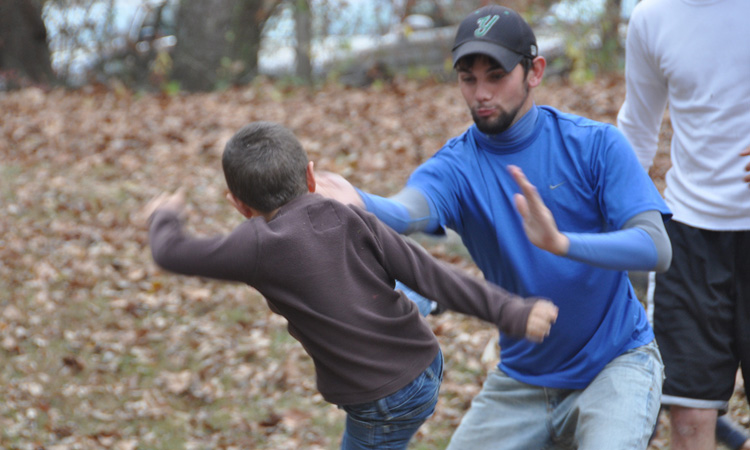 Father teaching son to defend himself