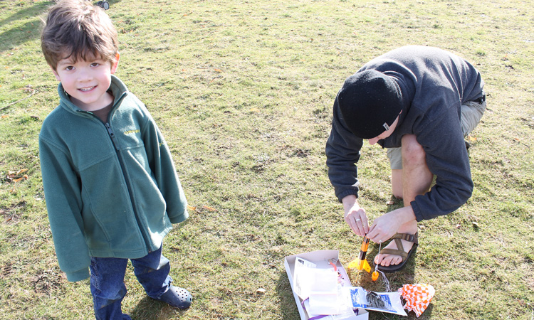 Father and son creating a rocket