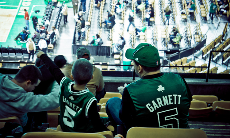 Father and son watching basketball