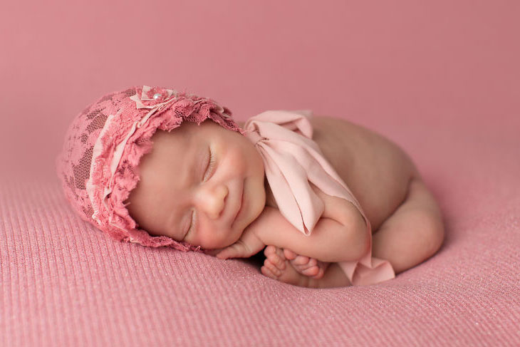 Cute baby dreaming and smiling